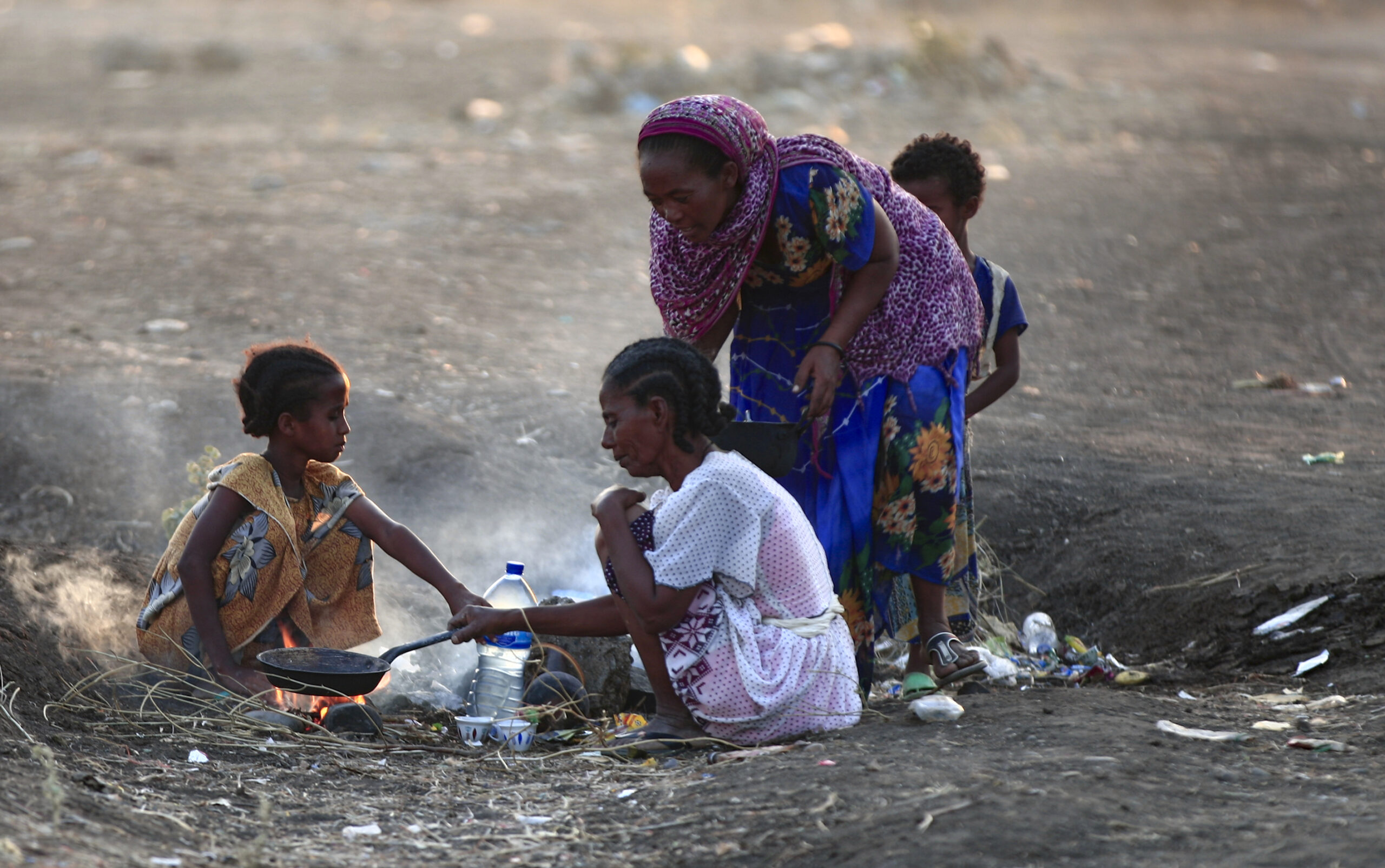 Ethiopian refugees who fled intense fighting in their homeland of Tigray, cook their meal in the border reception centre of Hamdiyet, in the eastern Sudanese state of Kasala, on November 14, 2020. - Ethiopia's Prime Minister Abiy Ahmed, winner of last year's Nobel Peace Prize, ordered military operations in Tigray last week, shocking the international community which fears the start of a long and bloody civil war. (Photo by Ebrahim HAMID / AFP) (Photo by EBRAHIM HAMID/AFP via Getty Images)